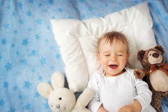 One year old baby with alarm clock Stock Images