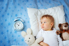 One year old baby with alarm clock Royalty Free Stock Image