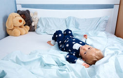 One year old baby in the bed Royalty Free Stock Photos