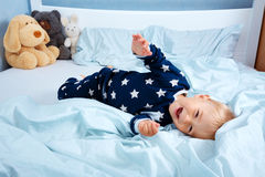 One year old baby in the bed Stock Image