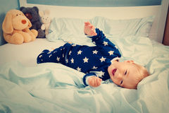One year old baby in the bed Royalty Free Stock Photography