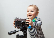 One year old baby boy with  camera Royalty Free Stock Photography