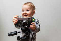One year old baby boy with  camera Stock Image