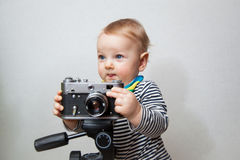 One year old baby boy with  camera Stock Photo