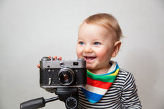 One year old baby boy with  camera Royalty Free Stock Images