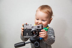 One year old baby boy with  camera Royalty Free Stock Photo