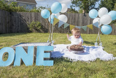 One year old baby boy chocolate cake smash Stock Images