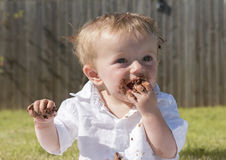 One year old baby boy chocolate cake smash Royalty Free Stock Photos