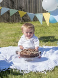 One year old baby boy chocolate cake smash Stock Photo