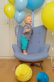 One year old baby boy first birthday. Toddler child sitting in chair. Royalty Free Stock Photos