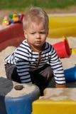 One year old baby boy toddler at playground sandbox Royalty Free Stock Image