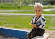 One year old baby boy toddler at playground sandbox Stock Photography