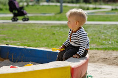 One year old baby boy toddler at playground sandbox Royalty Free Stock Photos
