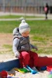 One year old baby boy toddler at playground sandbox Royalty Free Stock Images