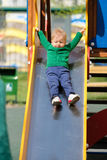 One year old baby boy toddler wearing green sweater at playground Royalty Free Stock Photos