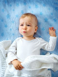 One year old baby crying. In bed stock images
