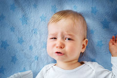 One year old baby crying. In bed royalty free stock images