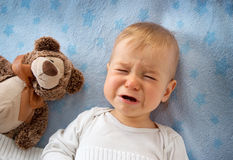One year old baby crying Stock Images