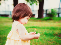One year old baby girl prtrait in profile outdoor Royalty Free Stock Image