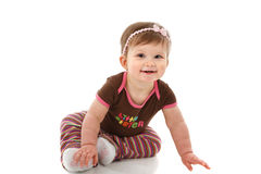 One Year Old Baby Girl Sitting on Floor Smiling Stock Images