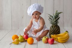 One year old baby. Little chef. Fruits.