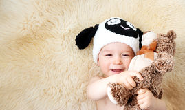 One year old baby lying in sheep hat on lamb wool Royalty Free Stock Photos