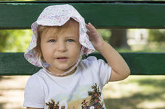 One year old baby portrait in a park wearing funny hat Royalty Free Stock Photos