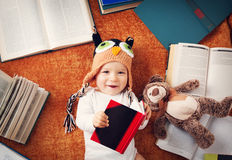 One year old baby reading books with teddy bear Royalty Free Stock Image