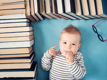One year old baby with spectackles and books Royalty Free Stock Image