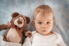 One year old baby with a teddy bear