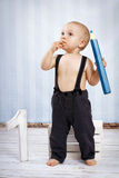 One year old boy with big crayon Stock Photos