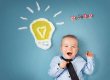 One year old boy and a bulb near. Child with an idea Royalty Free Stock Photography