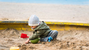 One year old boy playing in the sand box Royalty Free Stock Images