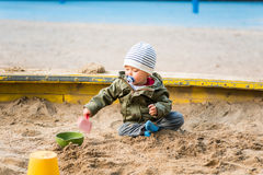One year old boy playing in the sand box Royalty Free Stock Photo