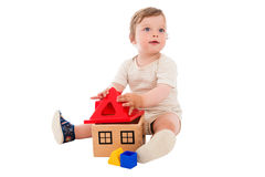 One year old boy playing with the toy Royalty Free Stock Image