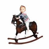 One year old boy riding on rocking horse stock photo