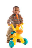 One Year Old Boy Riding Toy tricycles isolated Royalty Free Stock Images