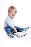 Boy with tablet Stock Photos