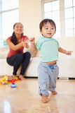 One Year Old Boy Taking First Steps With Mother Royalty Free Stock Image