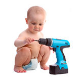 One-year old boy taking interest in screwdriver Stock Photography