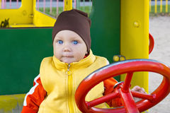 One year old boy at the wheel Royalty Free Stock Images