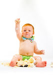 One Year Old Cake Smash. A baby boy gets to eat cake for the first time on his first birthday in this cake smash in studio against a white background royalty free stock images