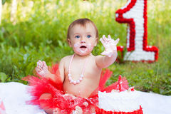 One year old child eating her first birthday cake Royalty Free Stock Photo