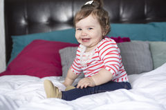 One year old girl in bed Stock Image