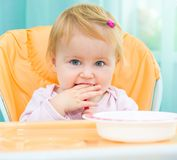 One year old girl in a highchair for feeding Royalty Free Stock Image