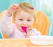 One year old girl in a highchair for feeding Stock Photography