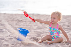 One Year Old Girl Playing in the Sand Stock Images