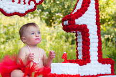 One year old girl sitting near celebration decorations Stock Photography