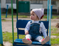 One year-old girl on a swing Royalty Free Stock Photos