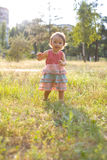 One-year-old girl on walk in park Stock Image
